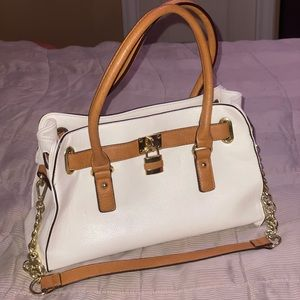 White and tan purse with gold chain and lock